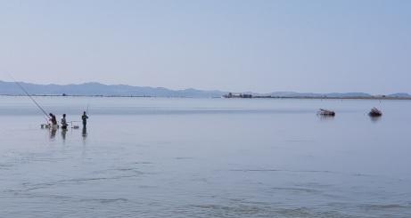 Pescadores en la Laguna e Patokut